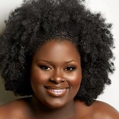 She's got great skin! Her curly 'fro is fabulous, definite like!