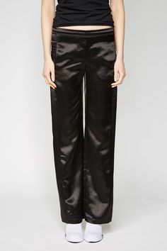 the zambesi PJ'S in black satin. - made in new zealand. - loose fit pj style pants - pull on elasticated waist - displaced side seams down front legs with pockets Black Satin, Pjs, Loose Fit, Leather Pants, Trousers, Pockets, Boutique, Shorts, Fitness