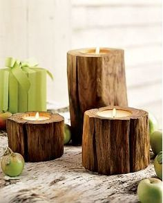 You can go to your local tree service company and ask if you can have some pieces of the trees they recently cut down. They will usually let you, as they want to get rid of the scraps to make room for more. Then you can get a drill bit and drill a whole into the log and insert a tea light.    website: http://grahamskracker.blogspot.com/2008/01/diy-rustic-wood-centerpiece.html