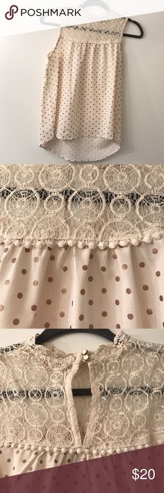 Polka dot, lace blouse Cream colored sleeveless blouse; buttons high at neck with white/gold buttons; worn once, excellent condition. Monteau Tops Blouses