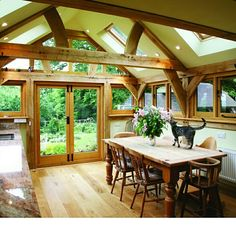 Check out some lovely wooden home adaptions. oak-designs.co.uk #oak #oakframe #kitchen #happycats #gardenroom