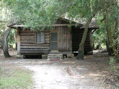 MUST STAY HERE!A path leads to one of the historic palm cabin under the trees. Places To See, Places Ive Been, Myakka River State Park, Urban Bike, Fort Myers, Log Cabins, State Parks, Paths, Vacations