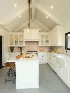 the floor is wood plank style porcelain tiles laid in a herringbone pattern.  I think the backsplash is subway tile made of carrera marble.  Cottage Kitchens from Jaymes Richardson : Designers' Portfolio 1576 : Home & Garden Television