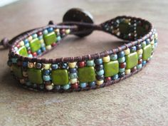Multi Color Seed Bead and Tile Bead Leather Bracelet, on ETSY. Love the colors in this piece!