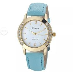 Geneva blue and gold watch NEW Brand new Geneva watch. Light blue, faux leather strap with gold border of watch frame. Accessories Watches