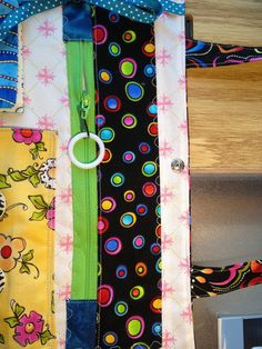 See instructions to make an Alzheimer's Activity Mat by Nancy Zieman .   I used that web page to begin my project. I added handles so it ca...