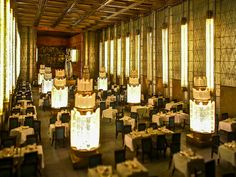 First Class dining room, SS Normandie (1935) illuminated by twelve tall pillars of Lalique glass, and 38 columns lit from within