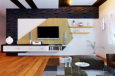 Living room is all about having a trendy TV unit. Check our latest trapezoidal modular panelling Tv unit design along with stone cladding #livinginteriors #modularTVunit #TVunit #design #decoration #bangaloreinteriors