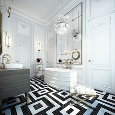 This chic Parisian bathroom has geometric tile flooring, a metal trough tub, tufted ottoman, grey wood cabinetry, high ceilings, wood paneled walls, and gold accents.