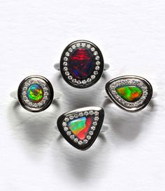 Check out the one that looks like a guitar pick! kickass! Black Opal Rings