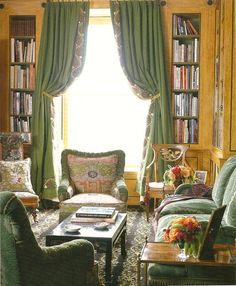 David Easton. Purple and cream decorative rug, yellow paneling, green drapes and sofa in upper east side library.