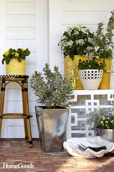 These coordinating planters in yellows and metallics create a fresh cascade of greenery, also perched on side-tables and stools. Get creative with storage, like this over-sized sea shell to hold your potting tools! Porches, Dream Garden, Home And Garden, Outdoor Spaces, Outdoor Living, Porch Decorating, Holiday Decorating, Back Patio, My Secret Garden