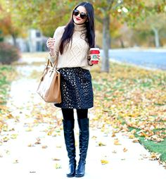 Magically slim your legs and whittle your waist by pairing opaque black tights with black Over-The-Knee boots, then slipping into a tulip skirt.