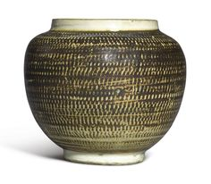 A SMALL 'CIZHOU' ROULETTED JAR. NORTHERN SONG DYNASTY