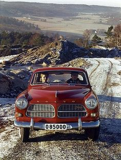 Our wedding car is a vintage Volvo Amazon in red, love it!