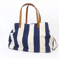Large Spacious Striped Tote with Leather Handles Tons and tons of storage space and pockets in this tote. Never worn. By the company Streetwise. Nautical stripes. Two snap closure pockets and one large middle zippered pocket with slots for your cell phone and makeup. Offers always welcome! Streetwise Bags Totes