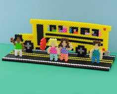 This fun project helps kids get in the mood for heading back to school. It's easy with Perler beads! Make it a family project, or present it as a gift to the teacher.