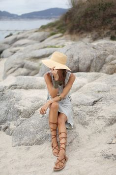 A modern take on the 70′s style combined with the vertical striped and gladiator sandals trend of this year. Via Silvia Garcia  Dress: Object, Sandals: Isabel Marant, Bag: Chloè, Hat: Raceu
