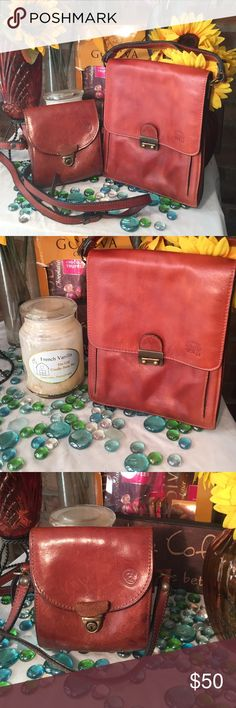 Cute Leather Bag Small Handle handbag No strap just a pouch w/ handle it doesn't come w/strap- Sz 8x10- Tan color- Genuine leather- Good condition- Made in Italy. Very nice! Bags Clutches & Wristlets