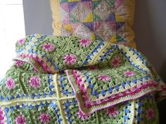Ravelry: SissyWoo's Lola's blanket -- Attic 24 Granny Square, love these colors. She used all #4 weight yarns, Caron Simply Soft in the pale pink, Vanna Baby in Sweet Pea, other Vanna yarn for the deeper green and the deeper pink, super saver for the pale yellow, and I can't remember what brand for the sky blue.  Every square is the same.