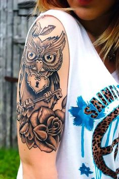 An owl holding a key and lock. This tattoo idea represents loyalty and inaccessibility. Style: Black and Gray. Color: Gray. Tags: Best, Beautiful, Meaningful