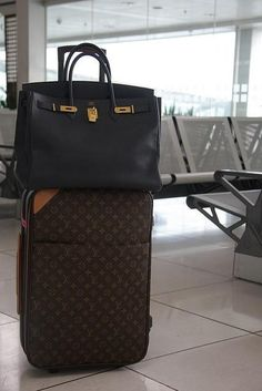 What a combination: Hermes Bag and Louis Vuitton Luggage.