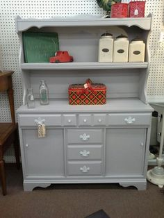 """$285 - This vintage 2 piece hutch has 2 drawers and double sliding door cabinet in base with open shelf hutch top. It has been painted a soft gray with white hardware.  It measures approximately 45"""" across the front by 17 """" deep and stands 31"""" to serving area and 63"""" at tallest point. It can be seen in booth C9 at Main Street Antique Mall 7260 East Main Street ( E of Power Rd ) Mesa, AZ 85207 480 9241122open 7 days a week 10a.m to 5 : 30p.m Cash, charge or 30 day layaway accept..."""
