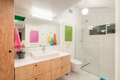 A floating Doug Fir plywood vanity + Duravit Happy D sink & wall hung toilet