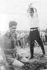 Prisoner of War being executed during the Bataan Death March in 1942