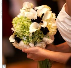 hydrangeas, calla lilies, peonies, sweet pea, and tea roses all in green and white