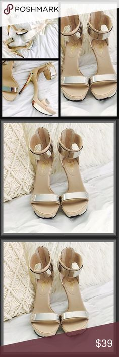 """Gorgeous Fergie platform heels These are Fergie's platform Heels, 5"""" inch heels, they tie at the ankle with a zipper in the back and have a silver frame in the front, the heels are like bone style with beautiful different colors. Fergie Shoes Heels"""