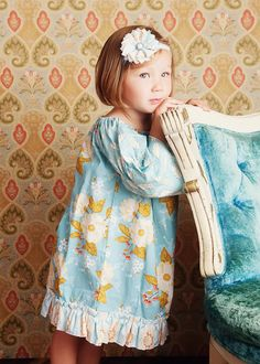Boutique Clothing Fall Girls Peasant Dress with Ruffles in Damsel Sky. $37.95, via Etsy.