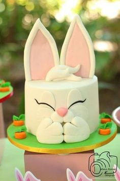 Love this bunny cake at an Easter picnic party! See more party planning ideas at CatchMyParty.com!