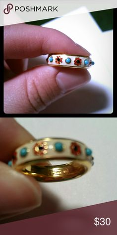 Coach Ring Gold ring with flower enamel. I am almost certain it is a size 6. Worn once. In excellent condition. Coach Jewelry Rings