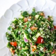 Tabouleh - A refreshing parsley salad with bulgur wheat, tomatoes, cucumbers and tomatoes dressed with a lemon vinaigrette.