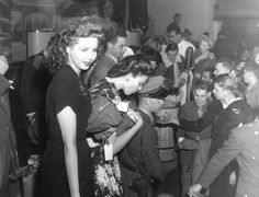 Ann Miller And Linda Darnell Hand Out Christmas Presents At The Hollywood Canteen
