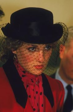 Diana in sombre mode, shrouded by a black veiled hat during a trip to the Birthright Centre in Sheffield hospital, April 1986. With its heightened - almost theatrical - air of gloom, it is a classic image of 80s style.