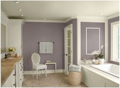 This purple bathroom would be a delight for anyone coming home from a stressful day at work. The soothing colors on the wall feature Benjamin Moore – Wet Concete on the walls (yes this is in the purple family, despite the name), Ceiling & trim are in Ivory Tusk and accent color: Stonington Gray
