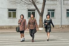 North Korea Lifestyle shopping no colors bland , no smiles , darkness, unhappy, no signs no many people anywhere.