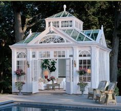 Love this conservatory/garden room! And the urns and flowers!