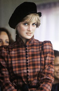 Diana smiles demurely at the Braemar Highland Games in Sept. 1982 in Scotland.