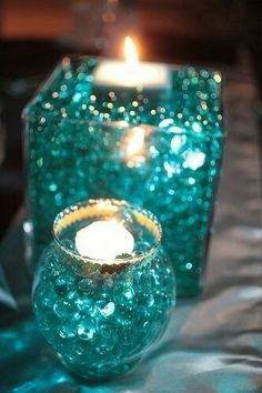 Top 7 Breath-Taking Blue Wedding Ideas to Brighten Your Day--gorgeous tiffany blue candle centerpieces , spring or summer weddings, beach weddings Non Floral Centerpieces, Candle Centerpieces, Centerpiece Wedding, Turquoise Centerpieces, Water Pearls Centerpiece, Centerpiece Ideas, Tiffany Centerpieces, Sweet 16 Centerpieces, Graduation Centerpiece
