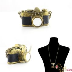 Vintage Compact Camera with Mirrored Lens Necklace: This amazingly detailed camera necklace is made of gold tone brass that's been partly covered in black leatherette and has a mirrored lens. The camera is around 1 inches wide on a long brass chain. Camera Necklace, Retro Camera, Brass Chain, Compact, Lens, 3d, Vintage, Black, Jewelry