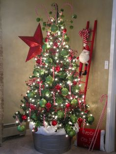 Cute little Christmas tree, perfect for foyer area or upstairs loft! Also love the ladder, would be cute having elves climb up it!