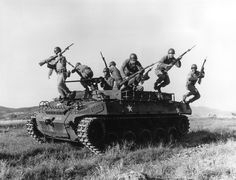 In Korean war an American soldiers leaping from an armoured personnel carrier during exercises in Korea, March Photo by Three Lions Armoured Personnel Carrier, Korean Air, American Soldiers, Armored Vehicles, Cold War, Military Vehicles, Heavy Metal, American History, Battle