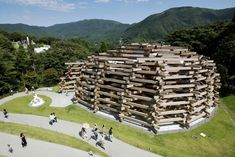 JA+U : Remarkable Japanese Timber Structures / Tezuka Architects - Woods of Net: Interlocking timber logs are stacked to house this permanent installtion by colorful net artist Toshiko Horiuchi Macadam.