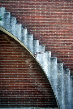 stairs arched against a brick wall.  Museumpark Orientalis in Heilig Landstichting, Netherlands. arch steps