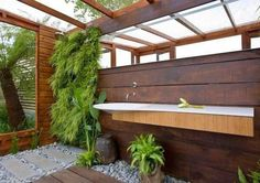 Bathroom: Awesome Modern Bathroom With Semi Outdoor Concept Featured Glass Roof Ideas With Vertical Garden With Wooden Wall And Ceiling: Extraordinary Outdoor Bathroom Design
