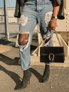 San Francisco style blogger Amber Richele of The Cocoa Butter Diaries shares how to add a little logomania and glam to her rocker chic look using Gucci tights, topshop distressed boyfriend jeans, Balenciaga knife boots, and Gucci Dionysus suede bag
