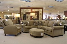 Transitional style sectional from Smith Brothers. Love the oval ottoman for this setting.